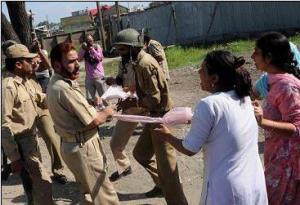 Indian Army beating Kashmiri Women