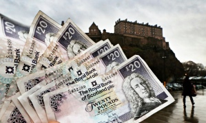 Twenty pound notes seen in front of Edinburgh Castle.